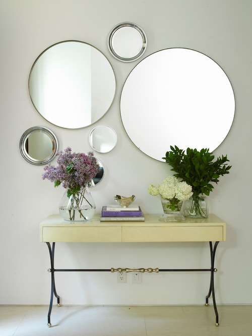 Hang multiple mirrors for a dramatic look